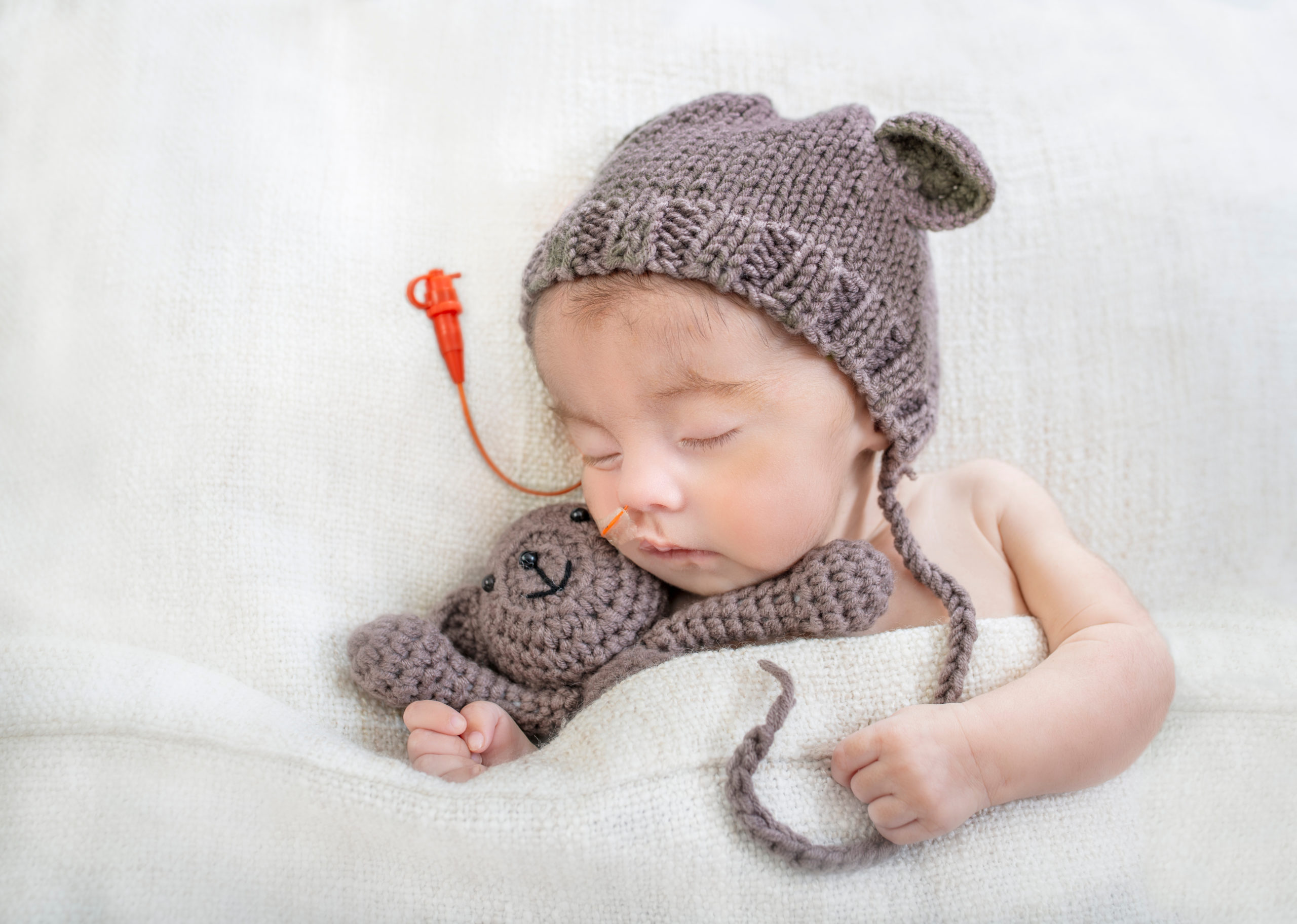 Sleeping,Special,Needs,Infant,With,Feeding,Tube,And,Teddy,Bear